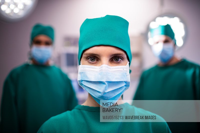Portrait of female surgeon standing in a operating room