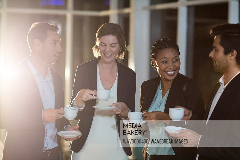 Group of businesspeople having coffee during break in the office