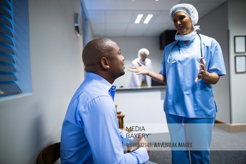 Female doctor interacting with patient in hospital