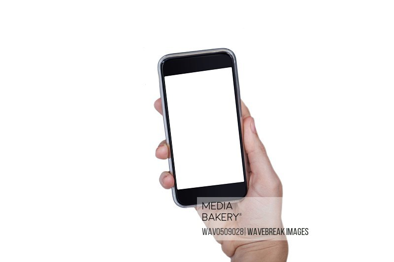 Hand holding mobile phone against white background