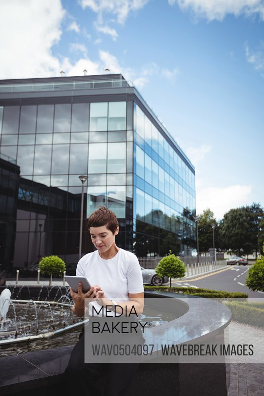 Businesswoman using digital tablet in office building