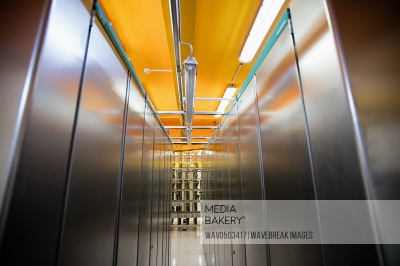 Hallway with a row of server rack in server room