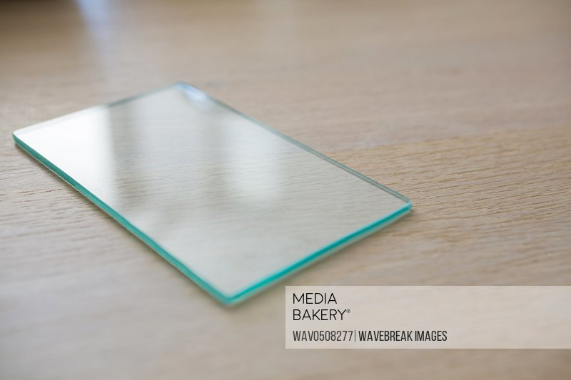 Piece of a glass on a table at home