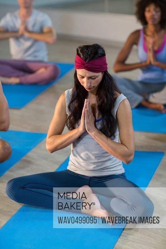 Young woman performing yoga in fitness studio