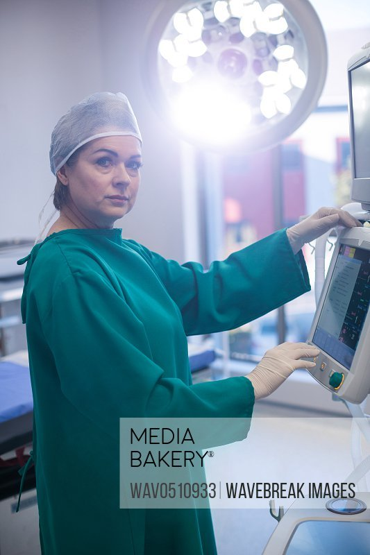 Portrait of female surgeon in operation room at hospital