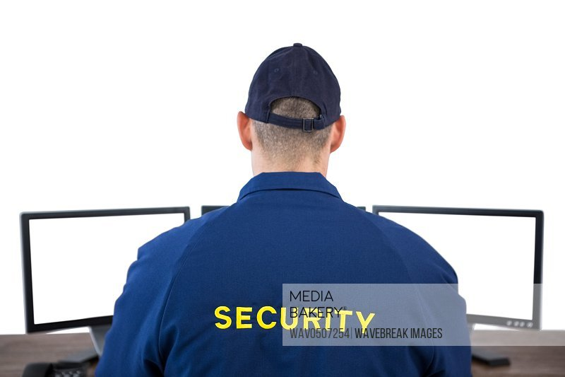 Rear view of security officer using computer against white background