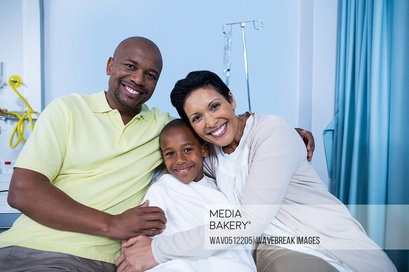 Portrait of smiling parents and patient in hospital