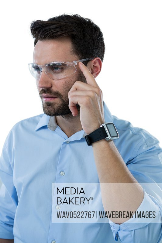 Man wearing protective eyewear and smart watch