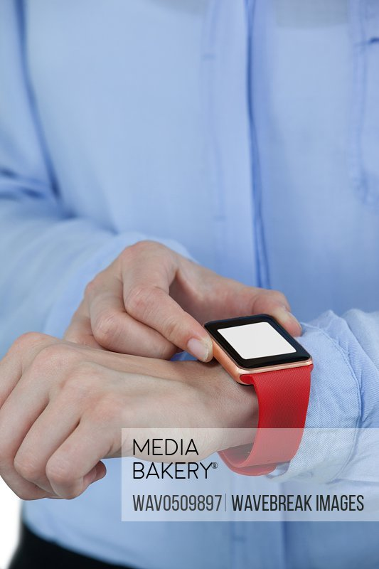 Mid section of businesswoman using smartwatch