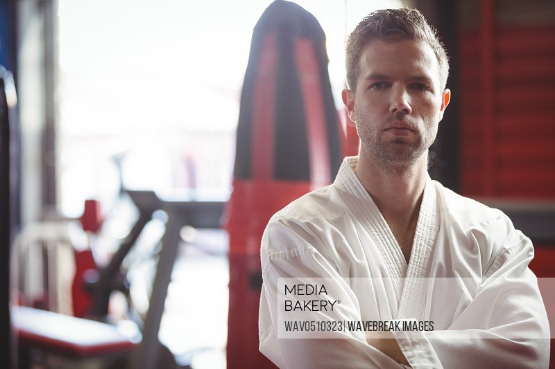 Portrait of a confident karate player in fitness studio