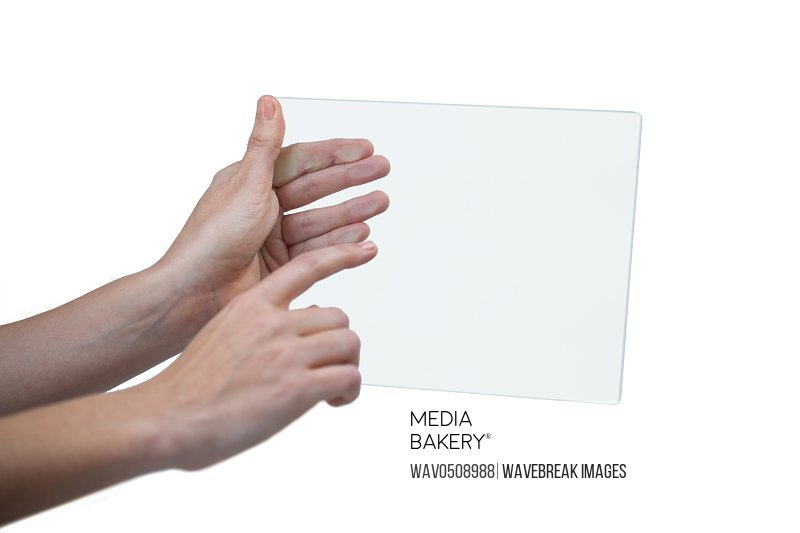 Hands of businesswoman pretending to use digital tablet