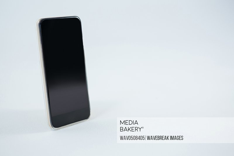 Close-up of mobile phone on white background