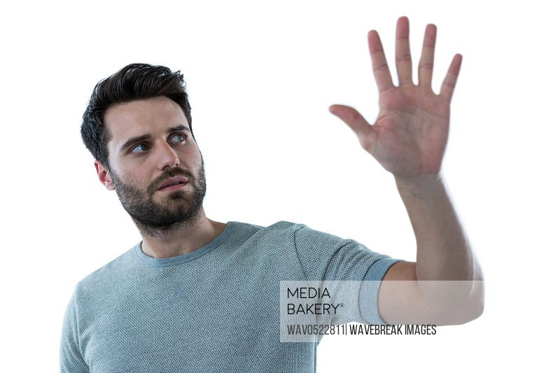 Man pretending to touch an invisible screen