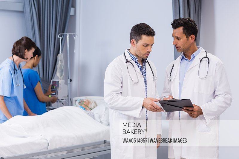 Two doctors discussing medical report