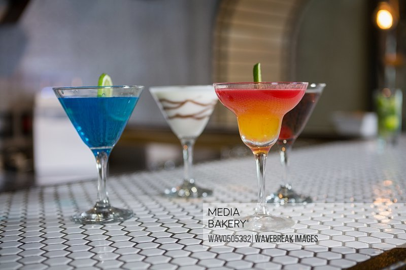 Various cocktails drinks on a bar counter in bar