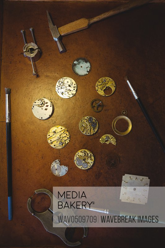 Horologists workshop with clock repairing tools on table