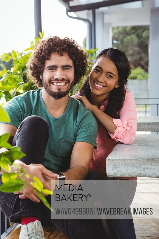 Portrait of couple smiling in cafeteria
