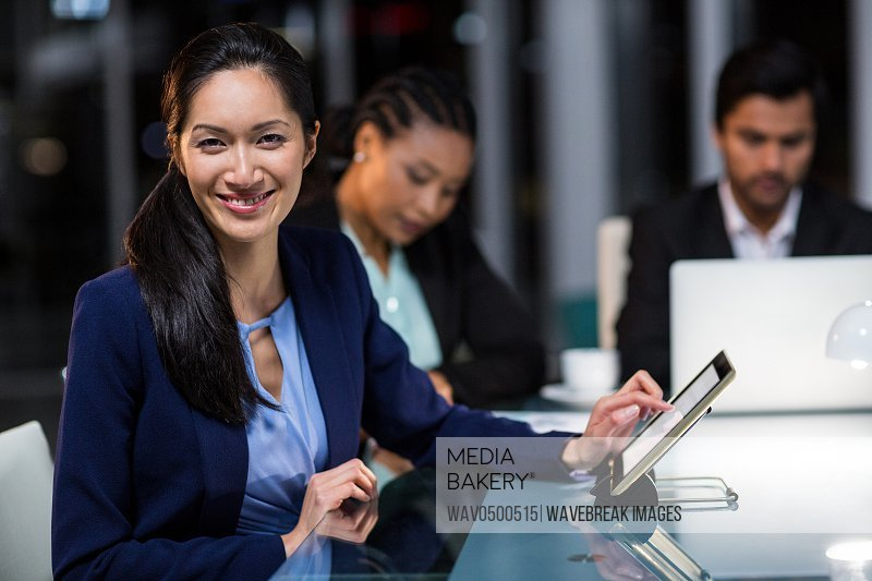 Portrait of businesswoman using digital tablet in the office