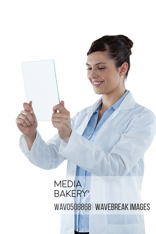 Beautiful female doctor holding digital tablet