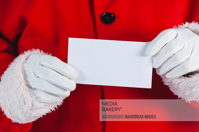 Mid section of santa claus holding blank placard