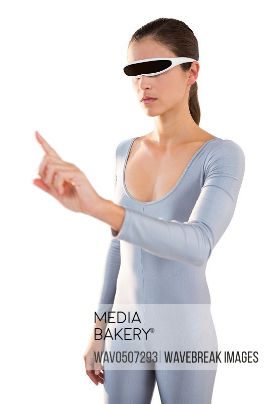 Woman in exercise outfit using virtual video glasses and pointing against white background