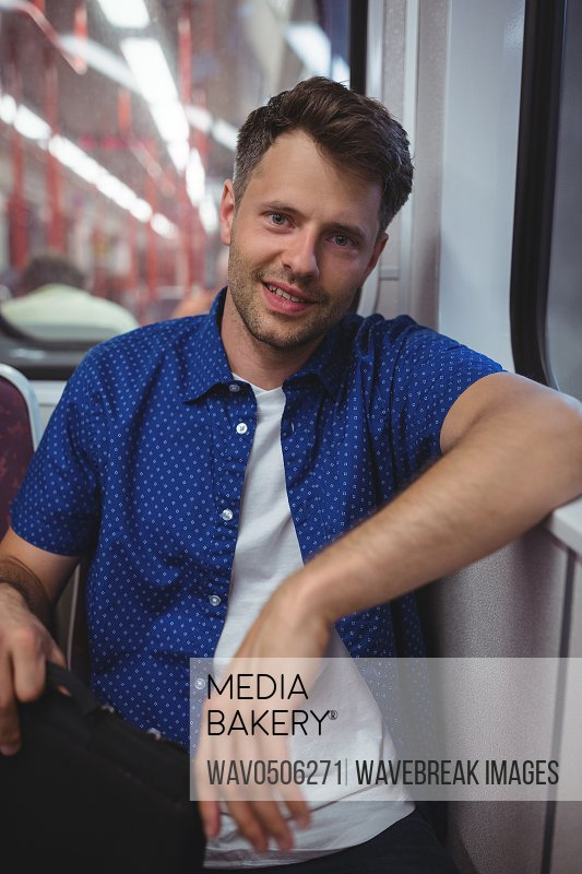 Portrait of handsome man traveling in train