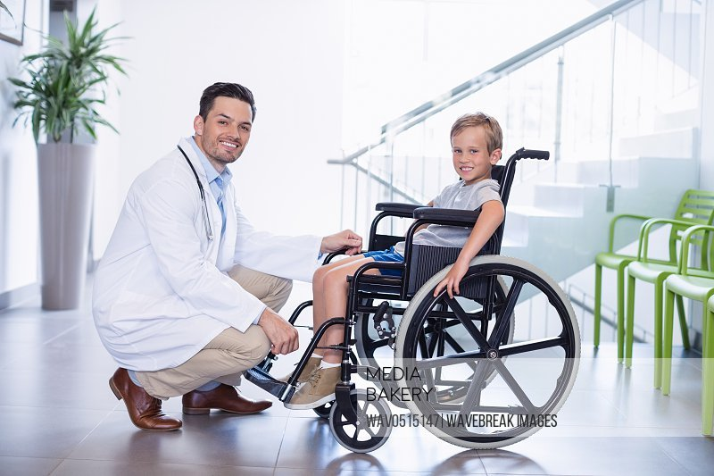 Portrait of smiling doctor and disable boy