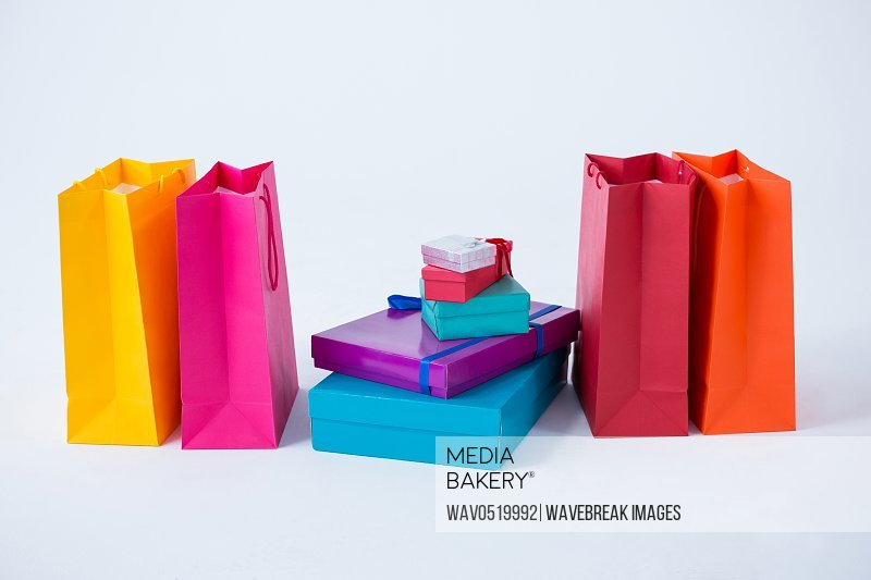 Stack of gift boxes with shopping bags