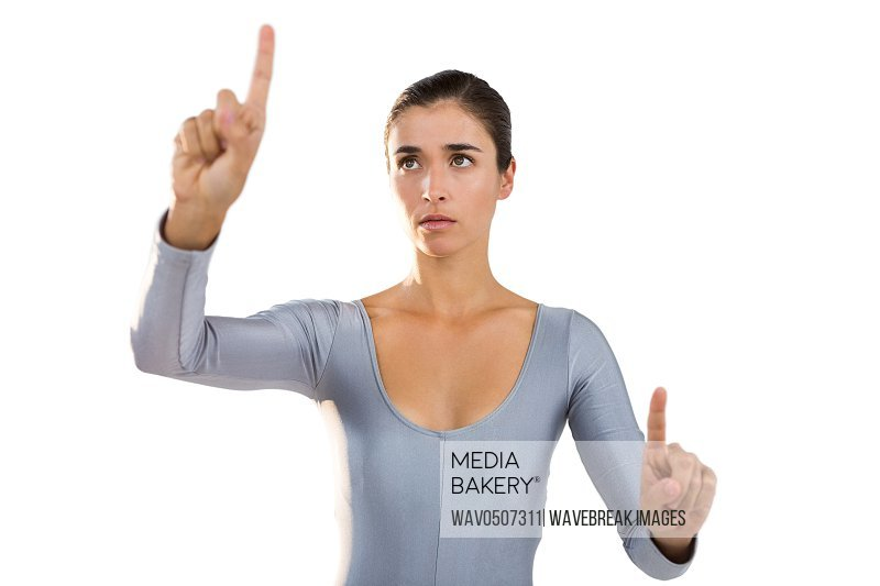 Confident woman gesturing against white background
