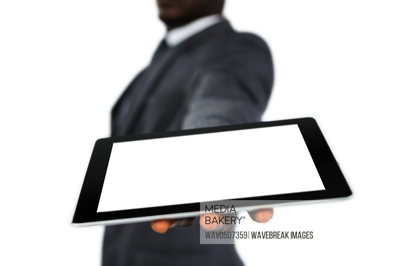 Mid section of businessman holding digital tablet on white background