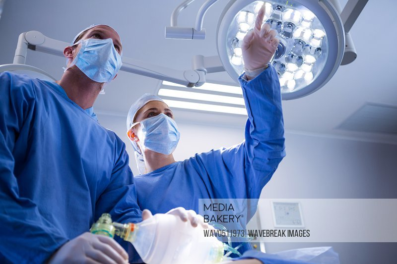 Surgeons interacting with each other in operation theater at hospital