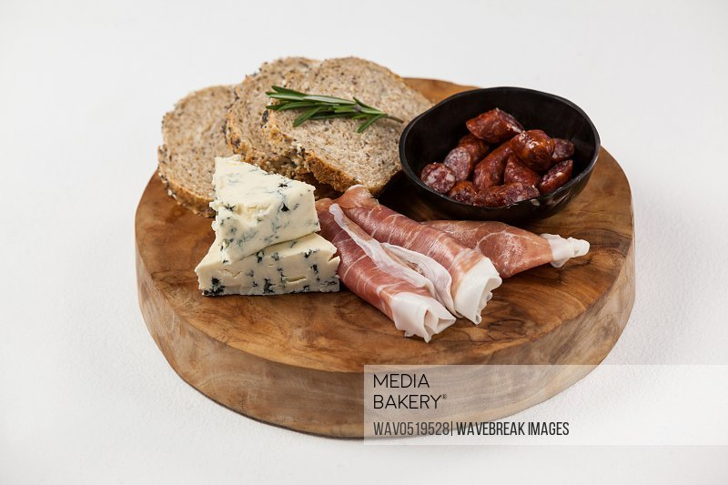 Bread slice cheese and meat on wooden board
