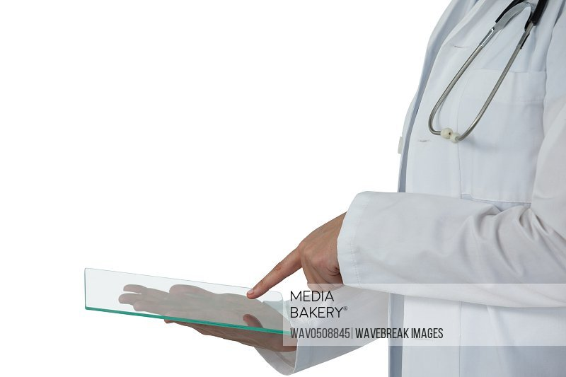 Mid-section of female doctor using digital tablet
