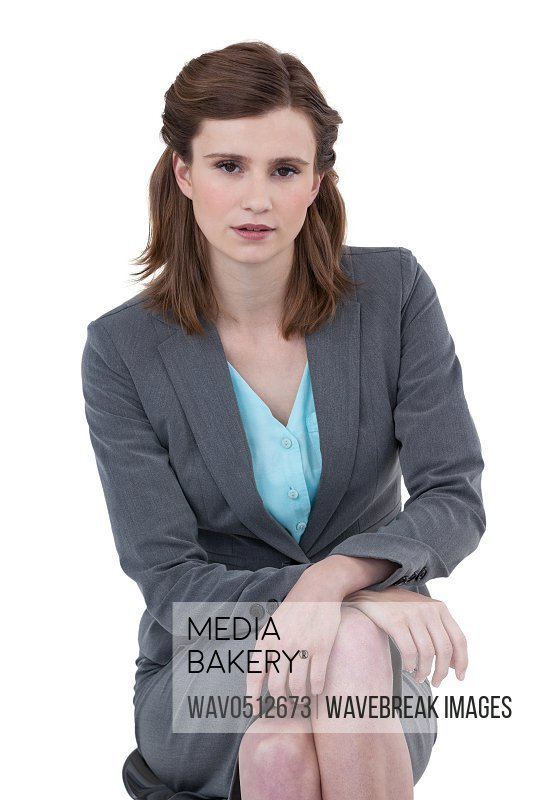 Portrait of businesswoman sitting on a chair against white background