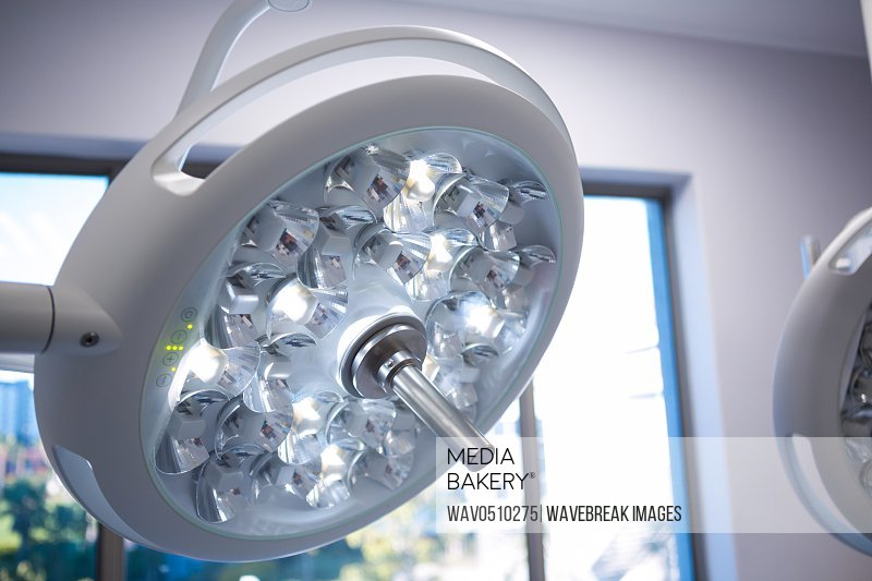 Close-up of surgical lights in operation room at hospital