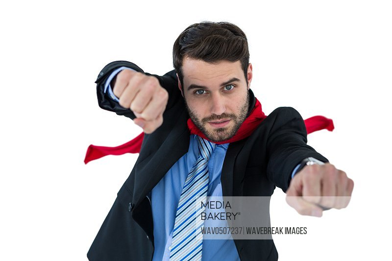 Portrait of businessman pretending to be a super hero on white background