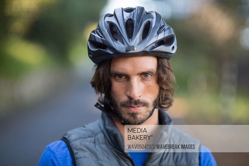 Portrait of serious male biker in countryside