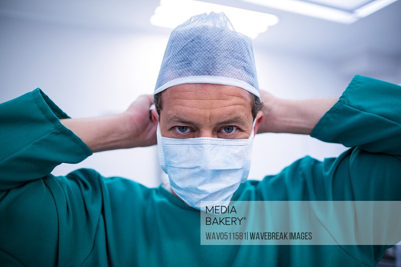 Surgeon wearing surgical mask in operation theater of hospital