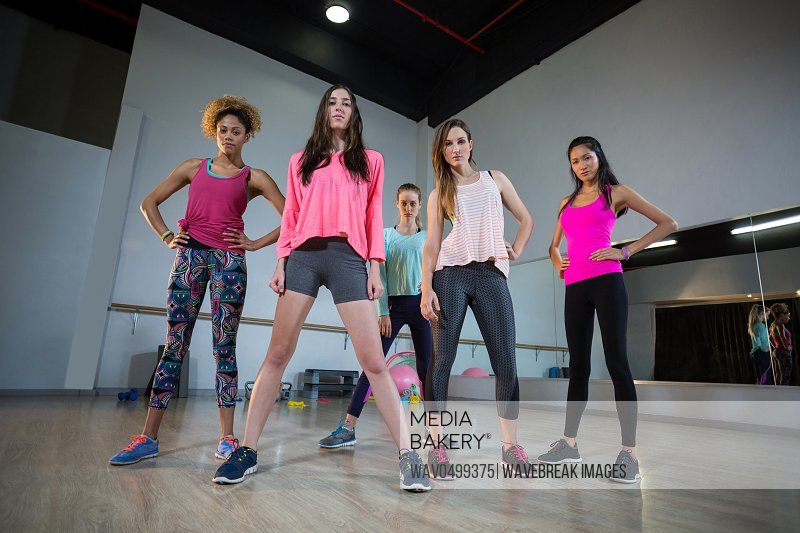 Group of women standing together in gym