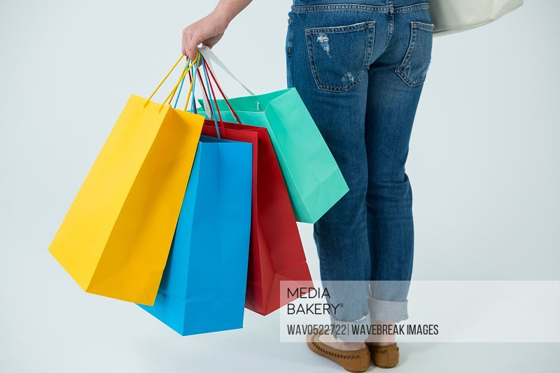 Woman carrying colorful shopping bags