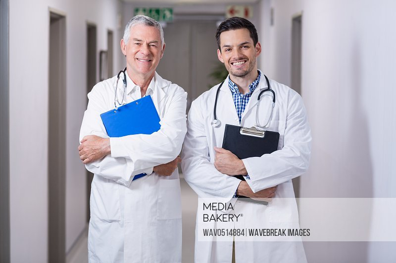 Portrait of smiling doctors standing together with clipboard