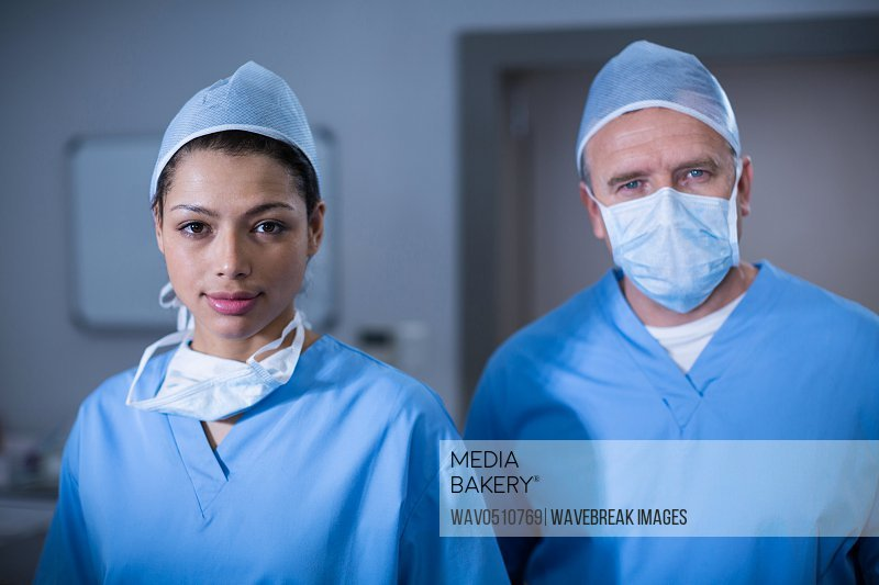 Portrait of surgeons standing in operation room at the hospital