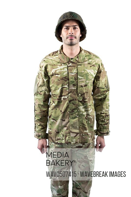 Portrait of confident soldier standing against white background