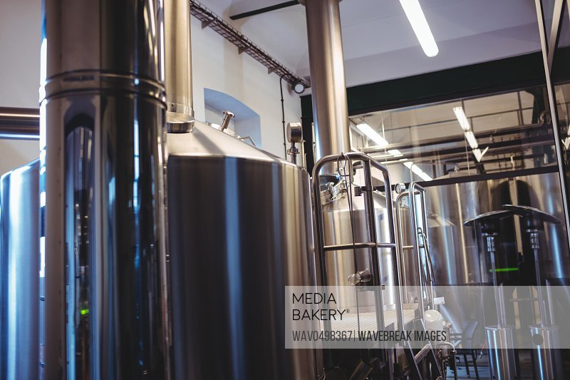 Industrial equipment at illuminated brewery