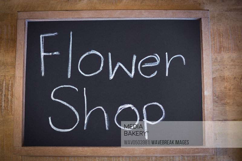 Close-up of slate with flower shop sign in the flower shop