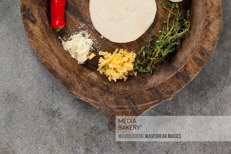Spices and vegetable with pizza dough