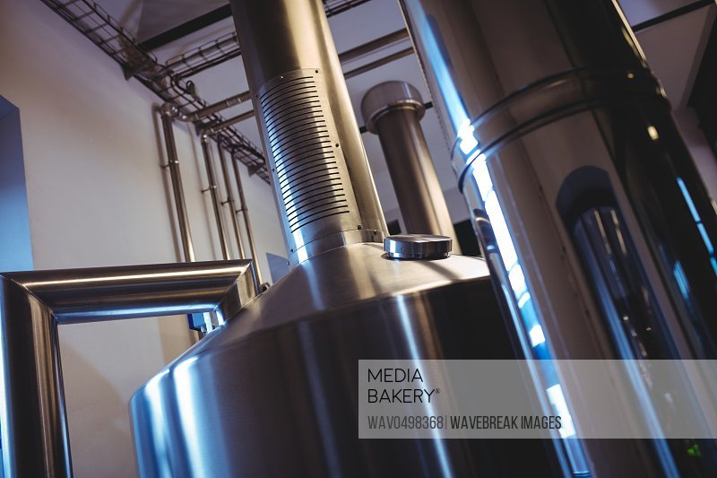 Low angle view of industrial machinery at brewery