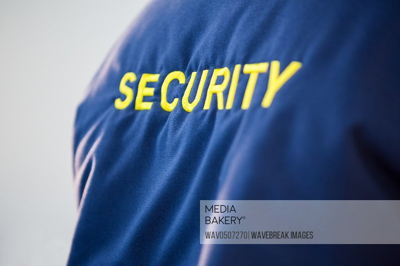 Close-up of text SECURITY on uniform