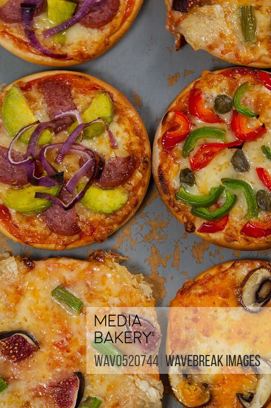 Various delicious italian pizza served on pizza tray
