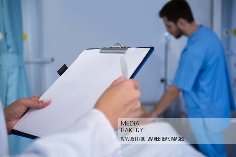 Doctor holding clipboard in hospital